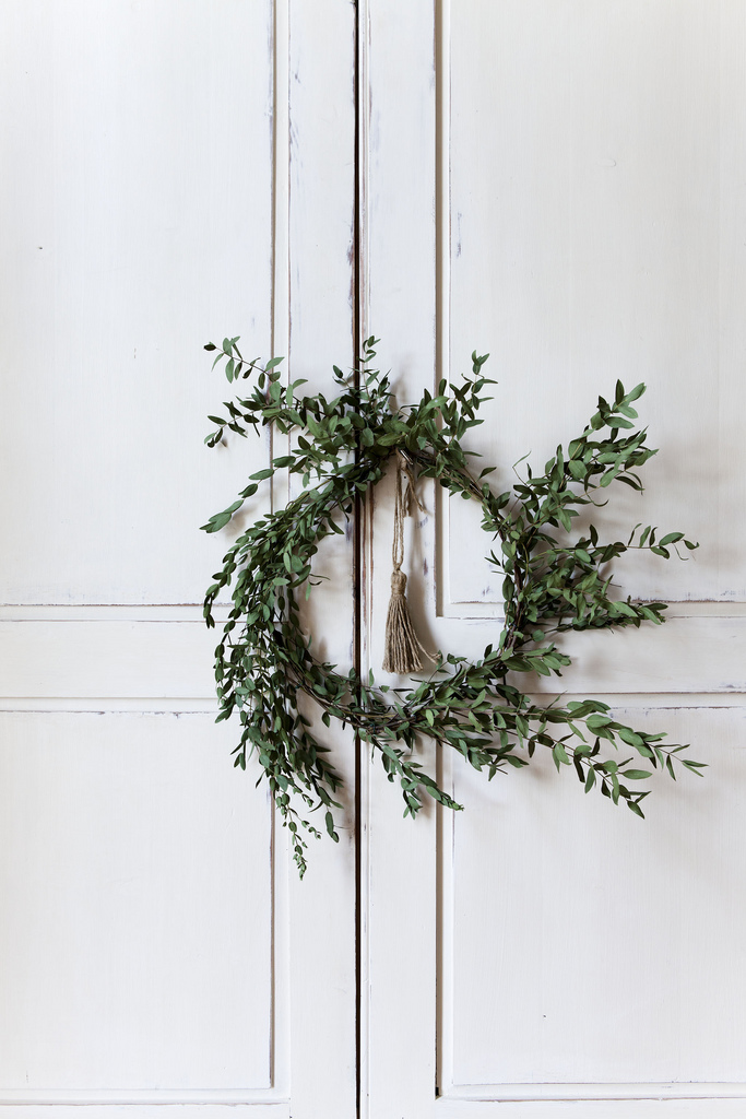 olive-wreath-on-white-washed-cabinet